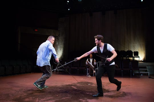 "Edmund Lewis and Andy Rindlisbach in a   scene from Alabama Shakespeare Festival's production of ""Hamlet,"" being presented by members of New York's Bedlam theater company. Four actors - Dria Brown, Edmund Lewis, Andy Rindlisbach and Mike Labbadia - play all the roles in productions of both ""Hamlet"" and ""Saint Joan"" at ASF."