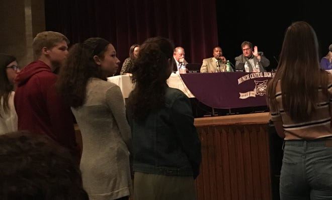 Muncie School Board President Jim Williams, right, on stage, questions members of Central High School's new student advisory council at the board's meeting in the school's auditorium on Aug. 27.