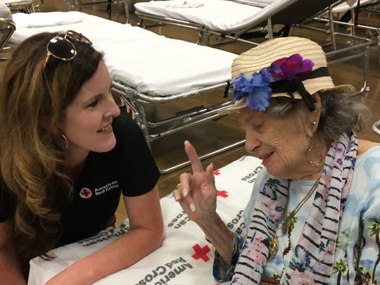 Red Cross Heart of Tennessee Chapter's executive director Kathy Ferrell talks with one of the elderly residents of Osceola County, Florida, who is staying at the shelter in anticipation of Hurricane Dorian.