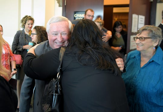 Deputy District Attorney Roger Moore his hugged by Burnette Chapel Church of Christ members outside the courtroom where Judge Cheryl Blackburn on Tuesday, Sept. 3, 2019 ruled on the sentences for 42 additional criminal counts related to Emanuel Kidega Samson and Burnette Chapel Church of Christ shooting.