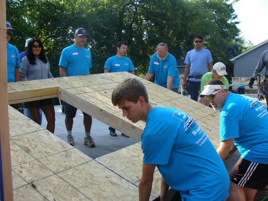 Volunteers from EXIT Real Estate Solutions help build a house for Habitat for Humanity. Soon, they'll also join former president and first lady Jimmy and Rosalynn Carter, who are coming to Nashville to help build homes for the nonprofit.