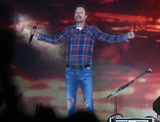 Dierks Bentley performs as the last act on the main stage Sunday at the Seven Peaks Festival in Buena Vista, Colo.
