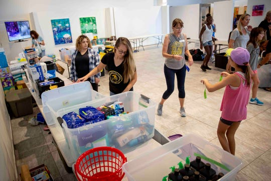 Volunteers sort through donations that will be taken to the Bahamas in the wake of Hurricane Dorian at Venue Naples on Tuesday, September 3, 2019.