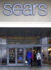In this Saturday, March 25, 2017, photo, shoppers enter the Sears department store in Schaumburg, Ill. On Friday, April 14, 2017, the Commerce Department releases U.S. retail sales data for March. (AP Photo/Nam Y. Huh)