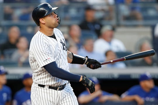 New York Yankees' Gary Sanchez watches his two-run home run during the first inning of the team's baseball game against the Texas Rangers, Tuesday, Sept. 3, 2019, in New York. (AP Photo/Kathy Willens)