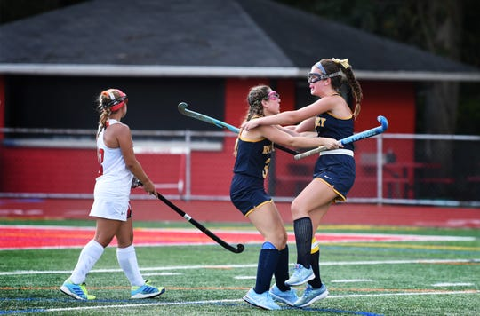Caroline Doherty (R, no.5, Capt) of Ramsey is congratulated by her teammate Claire Corriston (L, no.3) following her goal that makes 2 to 0 against of Northern Highlands in the second period of their game at Northern Highlands High School in Allendale on 09/3/19.