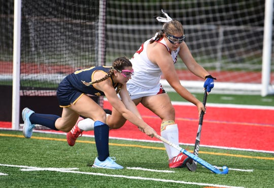 Claire Corriston (no.3) of Ramsey (in blue) battles against Nicole Garibaldi (no.42) of Northern Highlands (in white) for the loose ball in the first period of their game at Northern Highlands High School in Allendale on 09/3/19. Ramsey beat Northern Highlands 2 to 0.