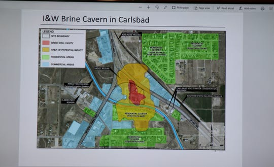 Eddy County Board of Commissioners and others view a map of the I&W Brine Cavern near Carlsbad during the Sept. 3 Eddy County Board of Commissioners meeting.