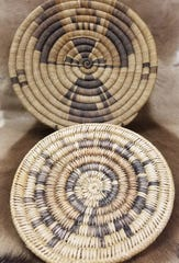Native American baskets like this often feature a coiled snake weave and geometric design.