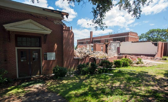 Demolition of the old McReynolds School in East Hill is underway on Tuesday, Sept. 3, 2019.