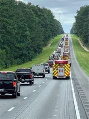 Fire engines drive east on Interstate 10 to assist with the response to Hurricane Dorian.