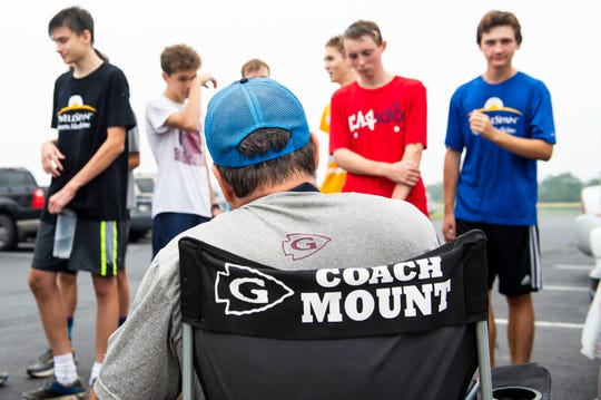 Brian Mount talks to his runners following an early morning practice at Gettysburg Area High School August 15, 2019. Mount has coached the boys' cross country team since 2013.