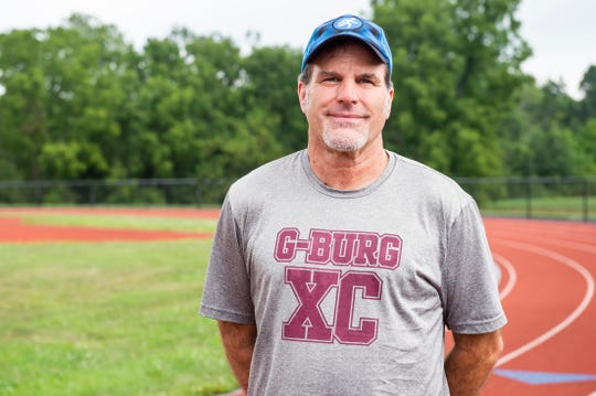 Brian Mount, Gettysburg Area High School's boys' cross country coach, poses for a photo behind the school in late August. In February, Mount suffered a stroke in his brain stem and was diagnosed with Wallenberg syndrome, a rare condition that accounts for less than five percent of strokes. After spending a week in the hospital and several weeks of speech, physical and occupational therapy, Mount has started running again.