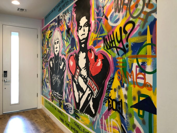 This graffiti art mural greets guests at the entrance. Artist Beau Bernd created this 16-foot-by-9-foot piece that is inspired by art icons Andy Warhol and Jean-Michel Basquiat, who are the Gilligans' favorite artists.