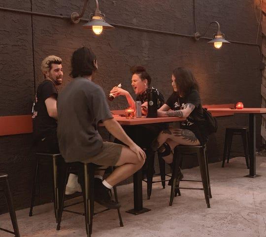 Friends gather at Linger Longer Lounge.
