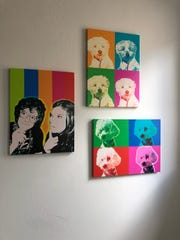The Gilligans' love for Warhol and pop art is displayed throughout their home. Here, they are featured alongside rescue dogs Baxter and Brixton.
