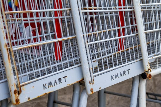 Rusted shopping carts are lined up outside the Marine City Kmart Tuesday, Sept. 3, 2019. It was announced last week that the store would be closing after nearly 40 years.