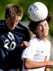 West York's Jake O'Brien, left, and York Suburban's Shane Buss vie for a header during soccer action at West York Tuesday, Sept. 3, 2019. Bill Kalina photo