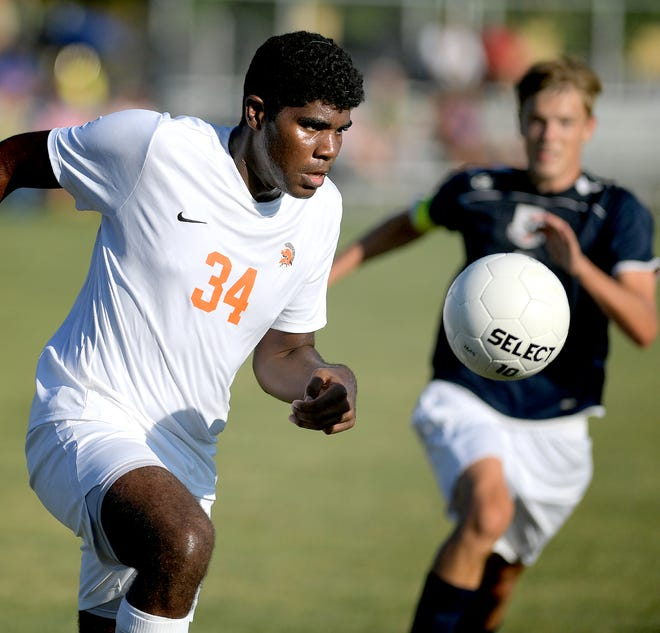 York Suburban's Anthony Brown, left, moves the ball with West York's Jason Bruder in pursuit during soccer action at West York Tuesday, Sept. 3, 2019. Bill Kalina photo