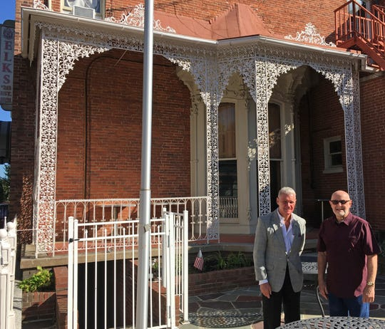 Skip Lehmann, left, and Bill Tomes stand in front of the newly painted ornamental iron work on the south side of the Elks Lodge 213 at 223 N. George St.