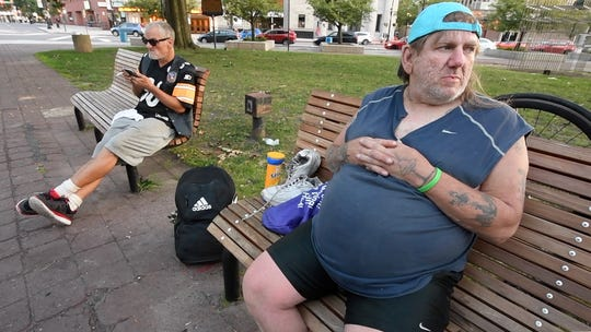 "Sean Mooney, sitting in Public Square Park in Wilkes-Barre, has been on the streets for 11 years. ""Donald Trump's the best,"" he said. ""He's the only president with any balls. He took on all of these other countries. When he makes his next term, I'm gonna write him a letter. Let him know I need help."""