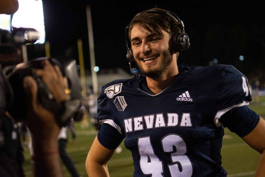 Nevada kicker Brandon Talton gives an interview after kicking a game-winning field goal against Purdue on Friday night.