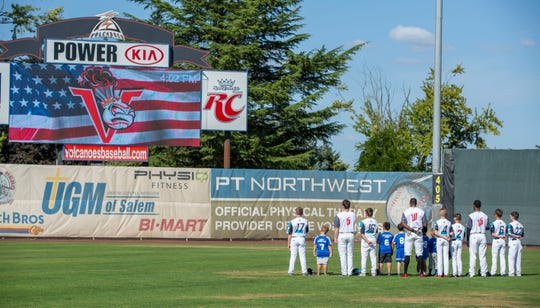 Members of the Sprague Little League All-Stars take the field for the National Anthem with Volcanoes players after they are recognized before the Salem-Keizer Volcanoes hosted the Eugene Emeralds at Volcanoes Stadium September 2, 2019.  The team was recognized for their performance in the Little League World Series.