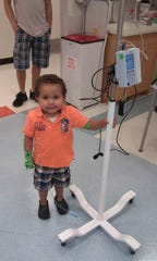 Trey Kearns, a Marylander who has the rare genetic disease PFIC, in the hospital around age 2.