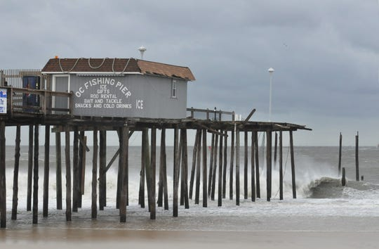 Waves crash on the damaged Ocean City Fishing Pier in the aftermath of Hurricane Sandy in 2012.
