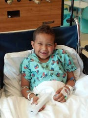 Trey Kearns, a Marylander who has the rare genetic disease PFIC, smiles in the hospital.