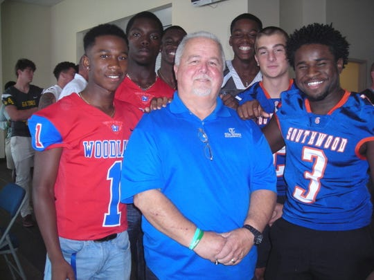 Times Sports Reporter Jimmy Watson with football players  at Jamboree Media Day