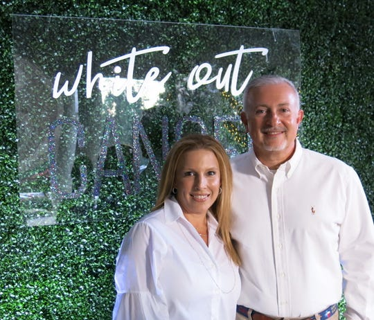 "Hope Ghali and hubby, LSU Health Shreveport Chancellor D. G.E. Ghali, a ""Champion of Hope,"" at White Out Cancer Ghala."