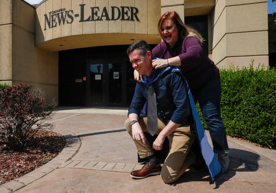 Former Captain Springfield Janelle Reed passes on the title and the cape to the newest captain, Michael Underlin, at the Springfield News-Leader on Tuesday, Sept. 3, 2019.