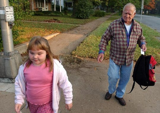 Lloyd Hoover died last week at 94. He fought in three wars and, according to his pastor, had a knack for fixing broken things.  Here, at the age of 78,  he walks his daughter, Josie, to school in 2003.