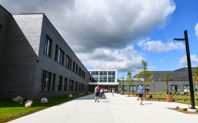 Students make their way into the main entrance of the new Sartell High School building for the first day of classes Tuesday, Sept. 3, 2019, in Sartell.