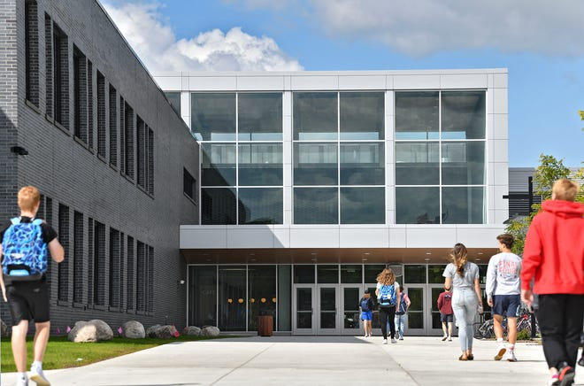 Students enter the new Sartell High School building for the first day of classes Tuesday, Sept. 3, 2019, in Sartell.