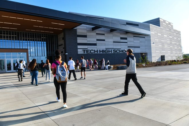 Tech High School first-year students make their way into the new school through the main entrance Tuesday, Sept. 3, 2019, in St. Cloud.