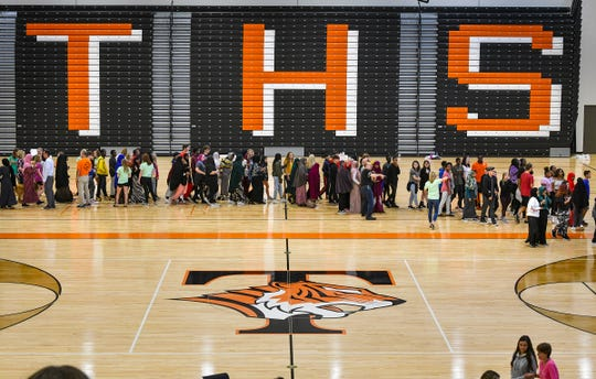 Students make their way into the new Tech High School gymnasium for an assembly on their first day of class Tuesday, Sept. 3, 2019, in St. Cloud.