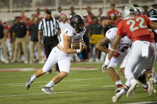 SUU quarterback Chris Helbig (8) runs against UNLV on Saturday, August 31.