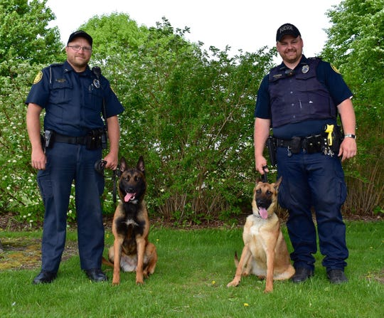Stevens Point Police Department began its police dog program in April 2018 with Luna and Fala. Officer Jeremiah Ballew   works with Luna (left) and Officer Austin Lee works with Fala (right).