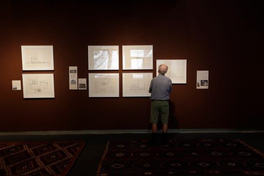 """Dwight Kingsbury takes a look at some of the items in the """"Identity in the Ottoman Empire"""" exhibit, on display at the Florida State University Museum of Fine Arts until Saturday, Nov. 9, 2019."""