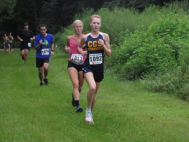 The top two women in the race, runner-up #1013 Lourena Maxwell and winner #1092 Morgan Wilson at the Bluebird Run on Labor Day.