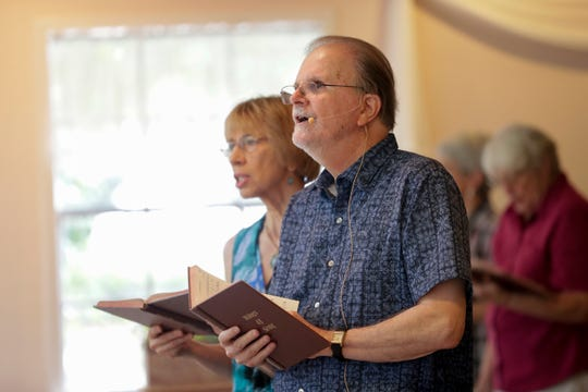 Rev. Bill Williams sings along with the Unity of Tallahassee church congregation during the 11 a.m. service Sunday, Sept. 1, 2019.