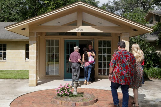 Rev. Bill Williams greets members of his congregation at the doors of Unity of Tallahassee church before the 11 a.m. service Sunday, Sept. 1, 2019.