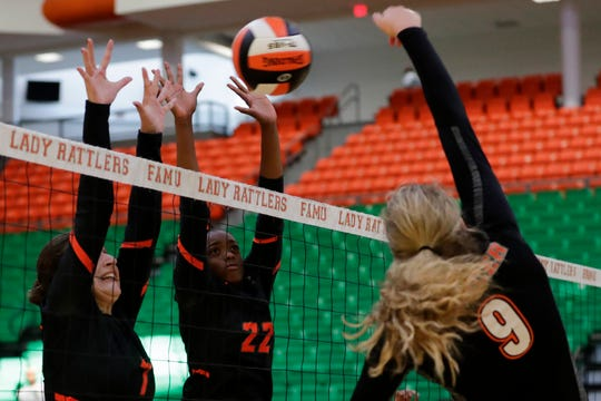 Florida A&M hitters Ilayda Nurkan (7) Alyssa Brown (22) jump to block a hit during a game between FAMU and Mercer at the Al Lawson Center Tuesday, Sept. 3, 2019.
