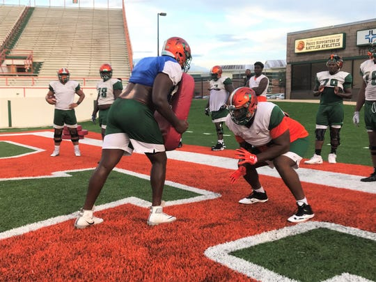 FAMU right tackle Calvin Ashley works on his block skills during practice. The former Under Armour All-American transfer from FAU joined the team in August.
