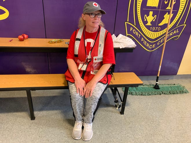 Carrie Odegaard, 52, is seated at a table in a county shelter located at Fort Pierce Central High School on Tuesday, Sept. 2, 2019. She travelled from her home in Shelly, Minnesotta to work as a disaster volunteer in Fort Pierce as Hurricane Dorian approached.