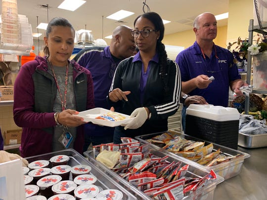 Principal Monarae Miller-Buchanan, center, and Fort Pierce Central High School staff serve snacks to shelter residents at one of the. St. Lucie County shelters located at FPCHS ahead of Hurricane Dorian on Tuesday, Sept. 2, 2019.