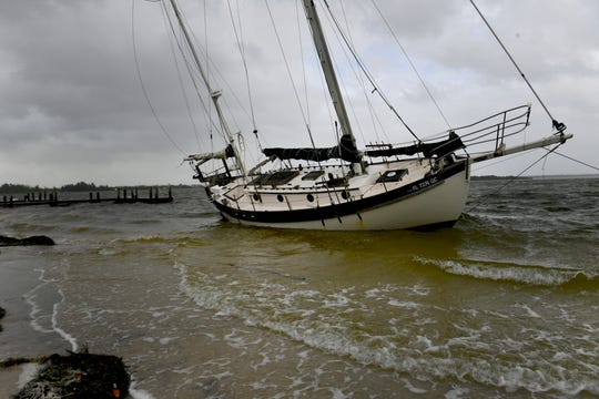 A sailboat washed ashore at South Causeway Park Tuesday Sept. 3, 2019, in Fort Pierce, as high winds and rain from feeder bands from Hurricane Dorian affects the Treasure Coast.