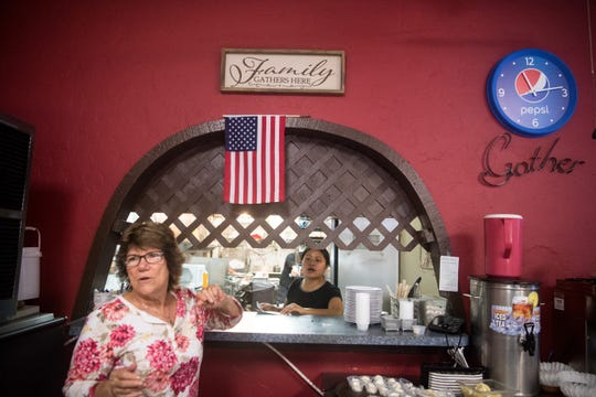 Susan Debula (left), of Hobe Sound, communicates an order for Karla DeLeon (center), of Stuart, who works in the kitchen at Morning Glory Cafe on Tuesday, Sept. 3, 2019, as area residents track Hurricane Dorian. Longtime regulars and friends pitched in to help serve at the longtime Stuart restaurant, which was one of the few open Tuesday morning.